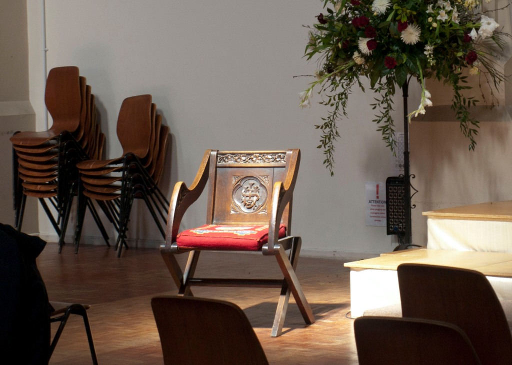 Photograph by Heather Dalton of well lit chair in a Protestant Church in Portsmouth, England.