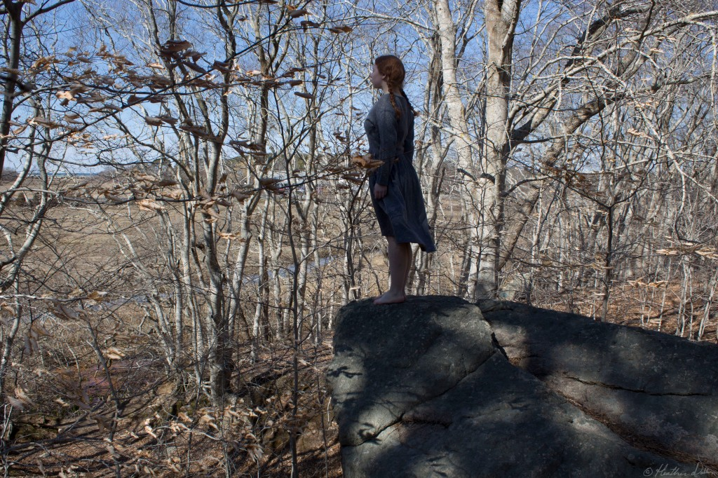 Photograph woman on cliff