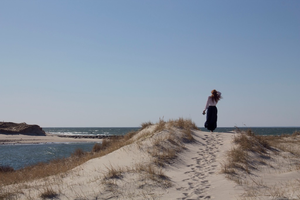 Photograph woman on dune