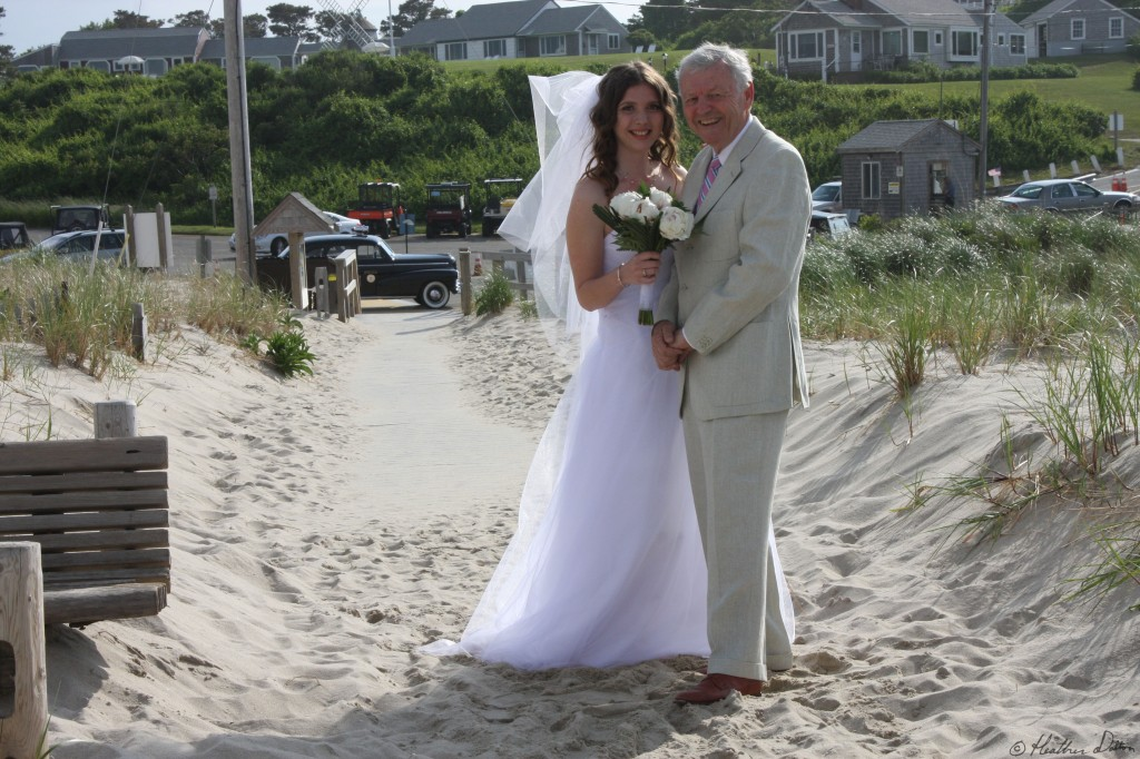 Bride and man walking down isle