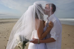 Wedding kiss under veil